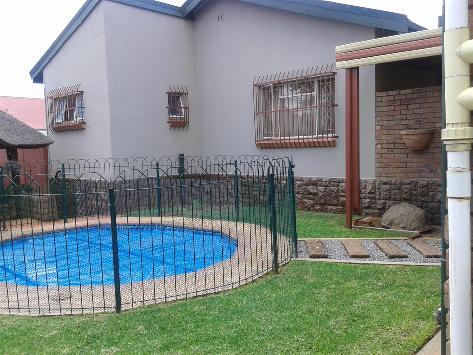 Close to Waterkloof Airforce base: Free standing house with  low maintanance stand, double tiled roofing, fireplace, tiles & laminated flooring