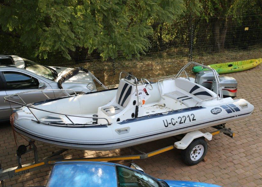Infanta semi ridged boat 2007.  Boat power to weight ratio is excellent with 2 x 50 Mariner outboard motors.