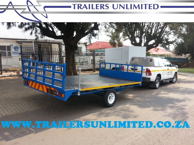 TRAILERS UNLIMITED CUSTOM FLATBED TRAILER.