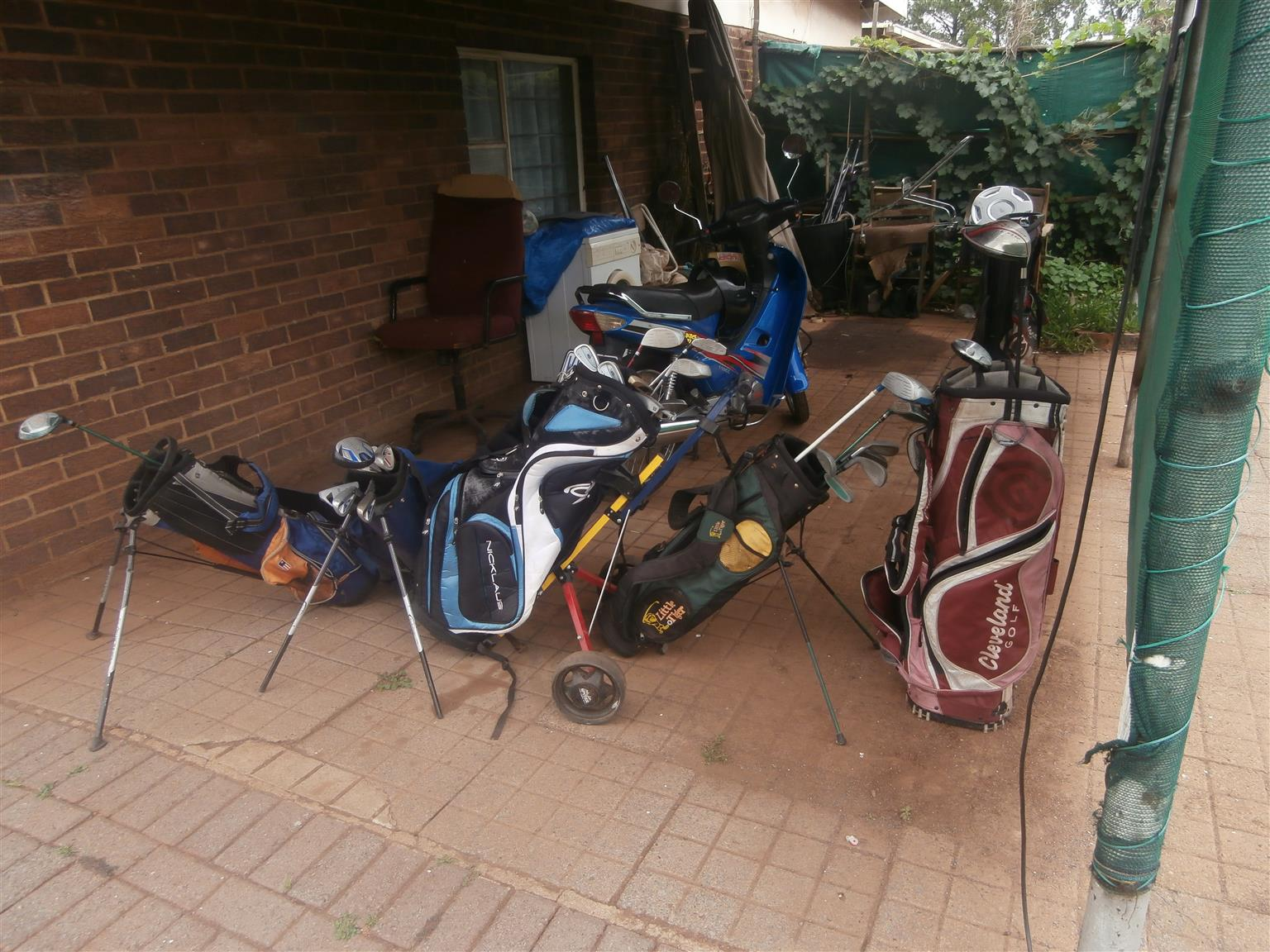 Golf kits,six bags  and sticks plus defy tumble drayer for cheap