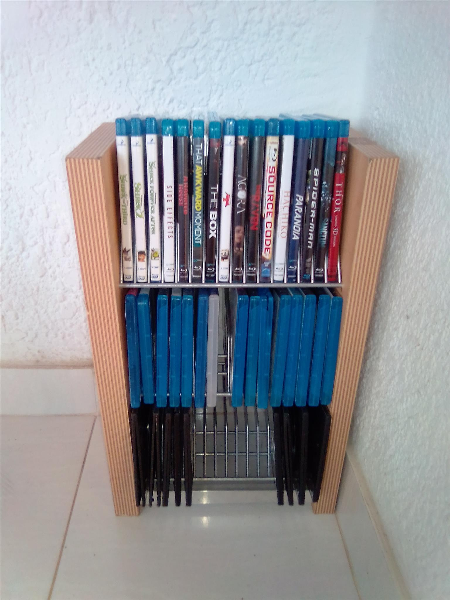 Blue Ray Disc Holder . Can hold up to 48 thin Blue Ray Discs.  As good as new. Wood and Metal.