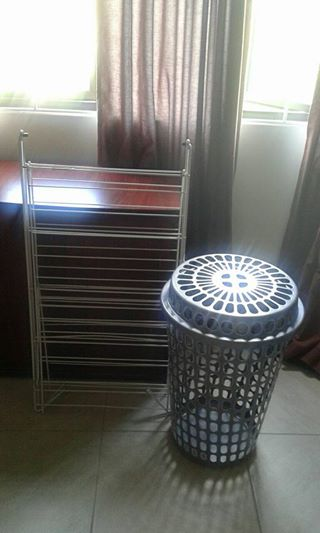 White metal clothes horse with washing basket