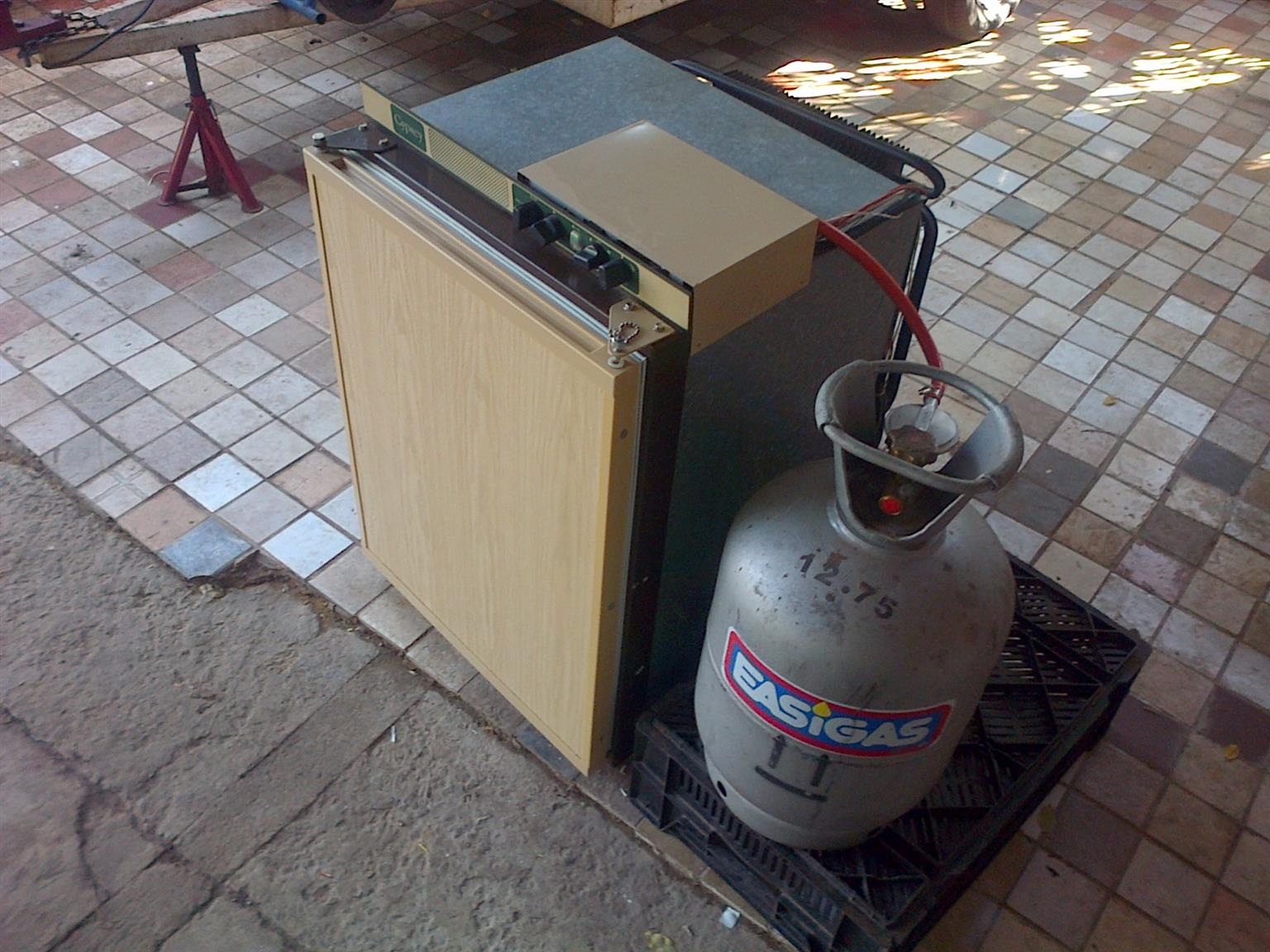 3 Way (12v/220v/gas) caravan or camping fridge with small freezer compartment inside in excellent condition and working 100% for sale - R2995 cash (including gas bottle + regulator) I CAN DELIVER for a small fee. WhatsApp/sms/call Pierre on 0825784861.