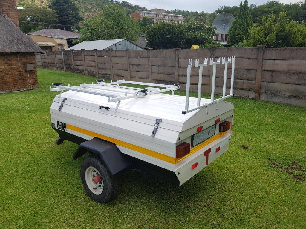 Venter Elite 6 trailer with nose cone as well as Bike Caddy 4 bicycle carrier