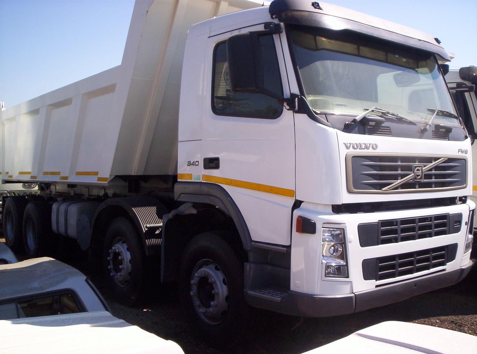 2004 VOLVO FM9 DOUBLE STEER 15 CUBE TIPPER.