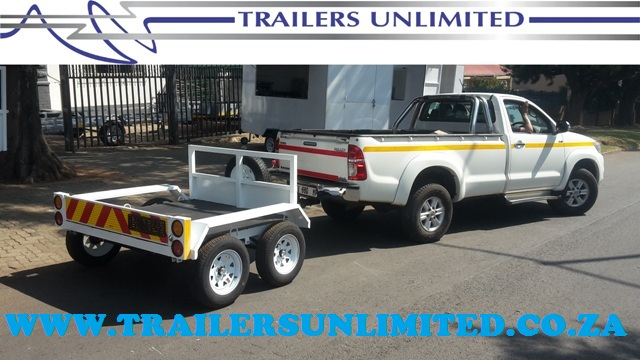 TRAILERS UNLLIMITED. DOUBLE AXLE FLATBED CUSTOM BUILD TRAILER.