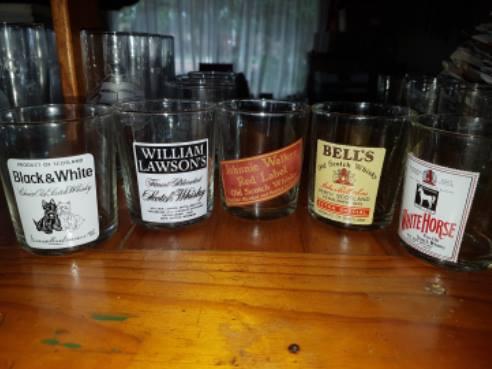 Various name brand whiskey glasses