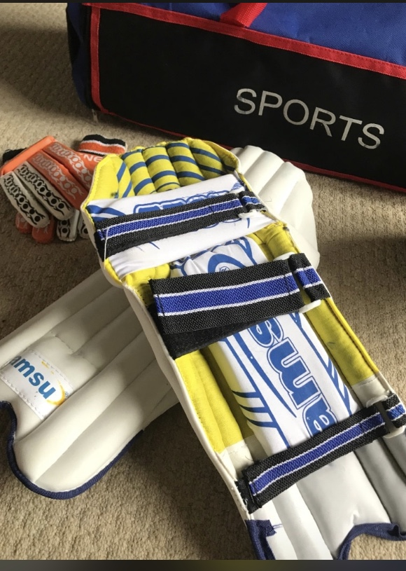 Cricket pads helmet and gloves