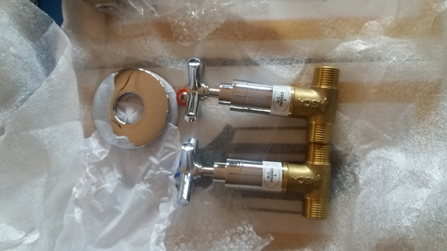 Various brand new shower mixers and  ISCA stop cocks