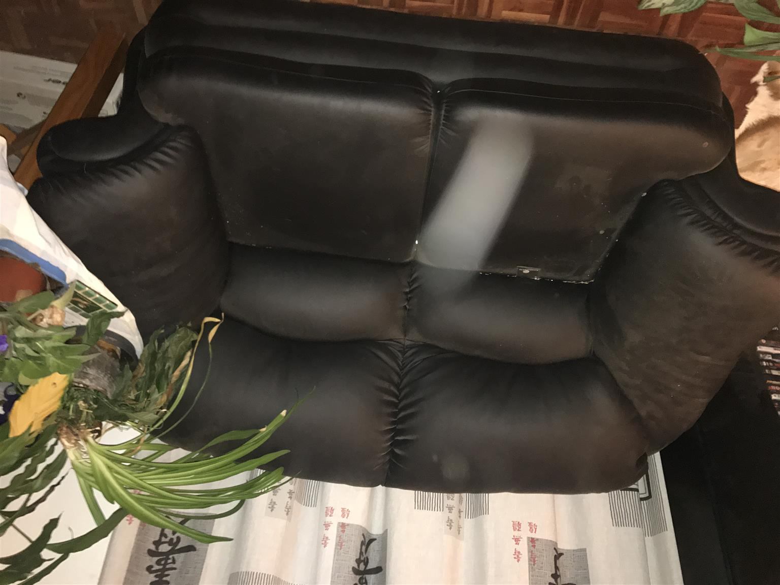 Black single lounge double sofa, in excellent condition