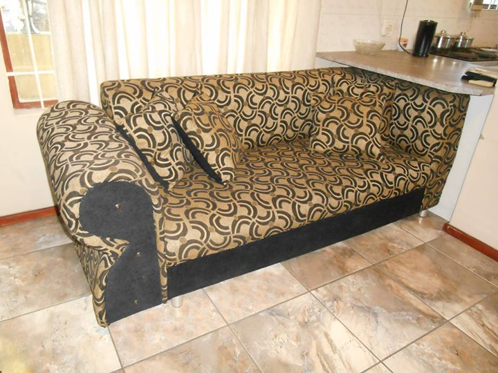 3 SEATER BLACK, GOLD AND BEIGE COUCH x 1
