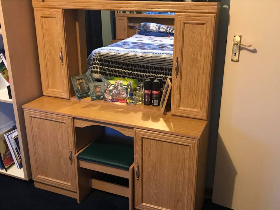 Light wooden dresser with mirror
