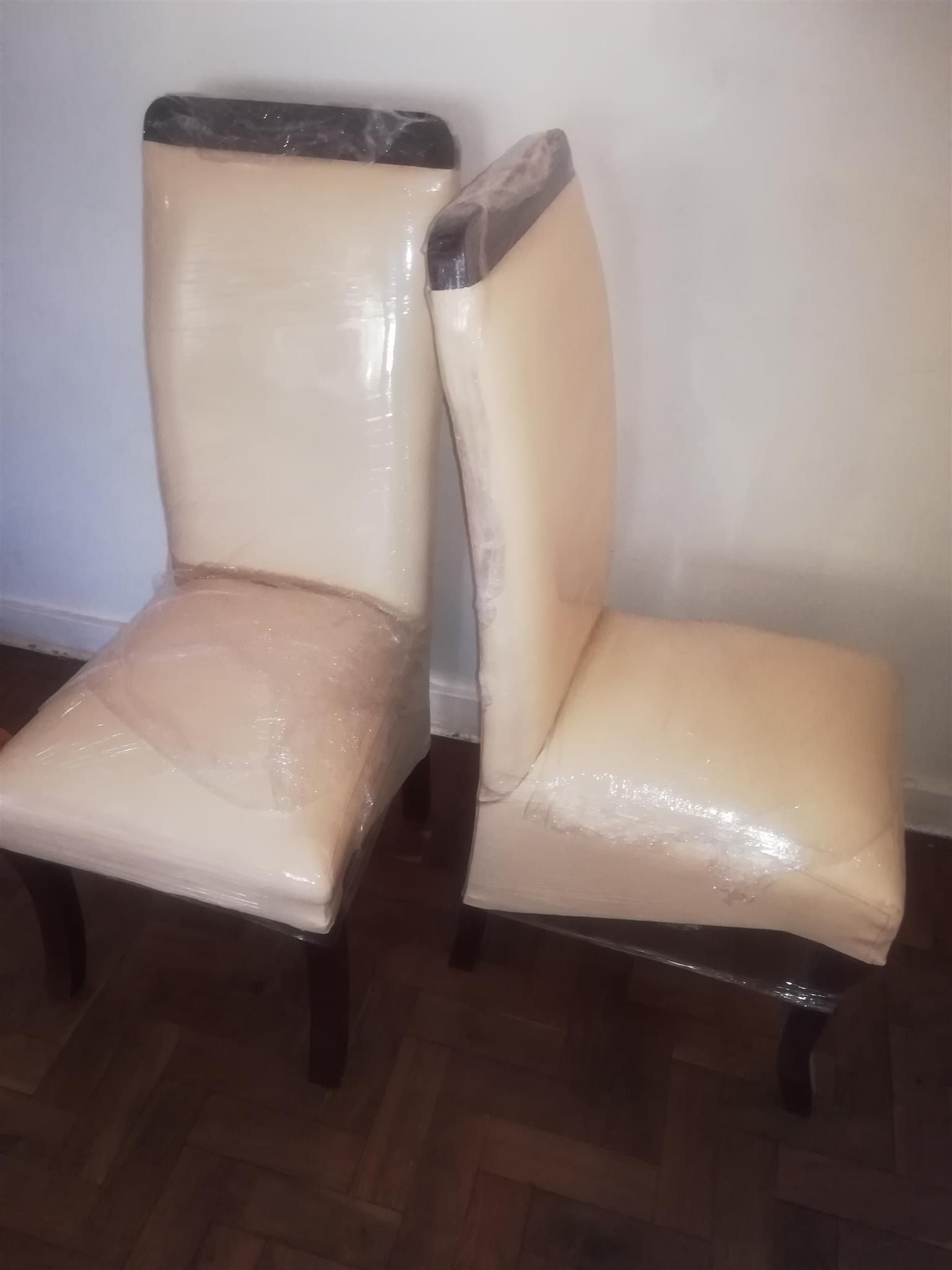 New cream and mahogany faux leather chairs