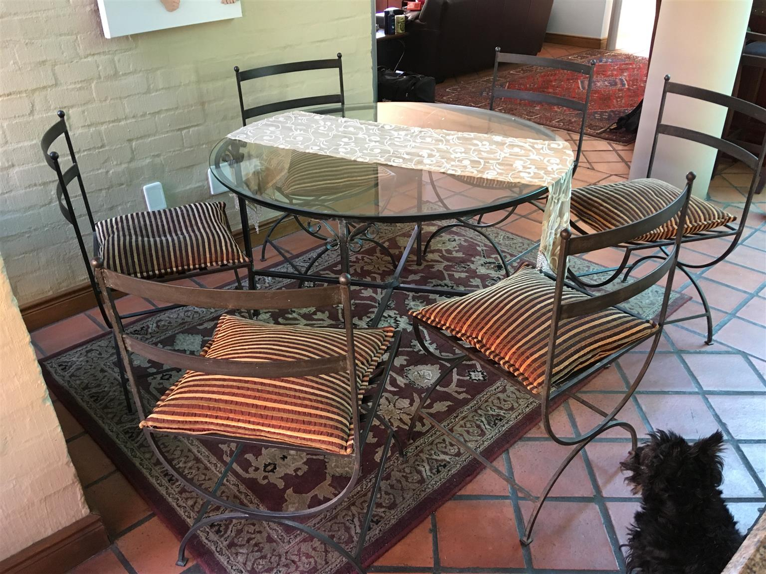 Table (round) with glass top and six chairs