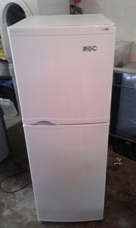 2 white kic freezer on top fridges