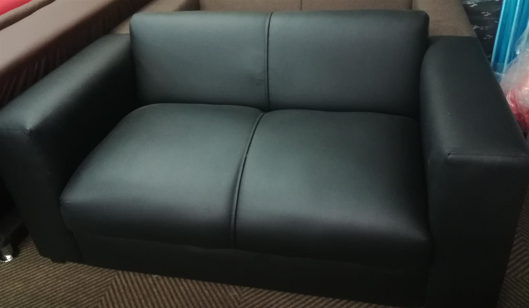 New black faux leather couch
