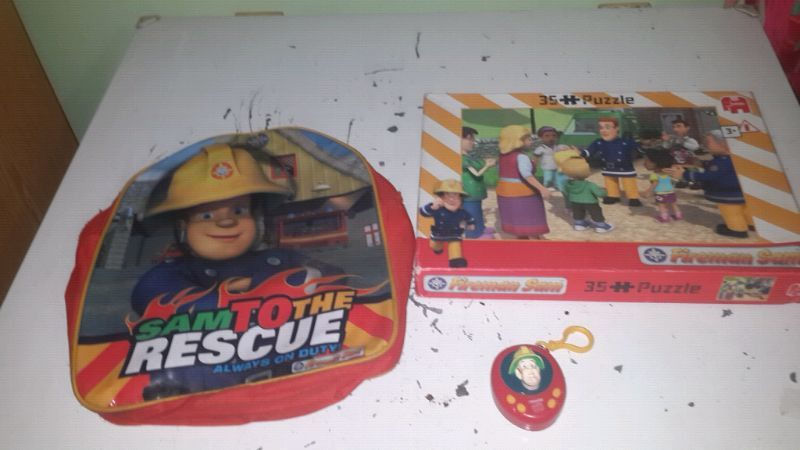 Fireman sam related items including. Back pack. Slippers(size10).Puzzle.Novelty toy , playing cards. R 180