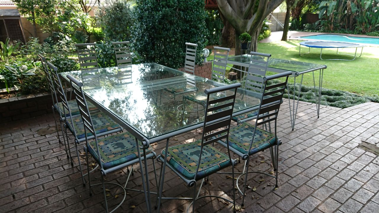 Patio set, 10 seater custom made wrought iron table with sideboard.