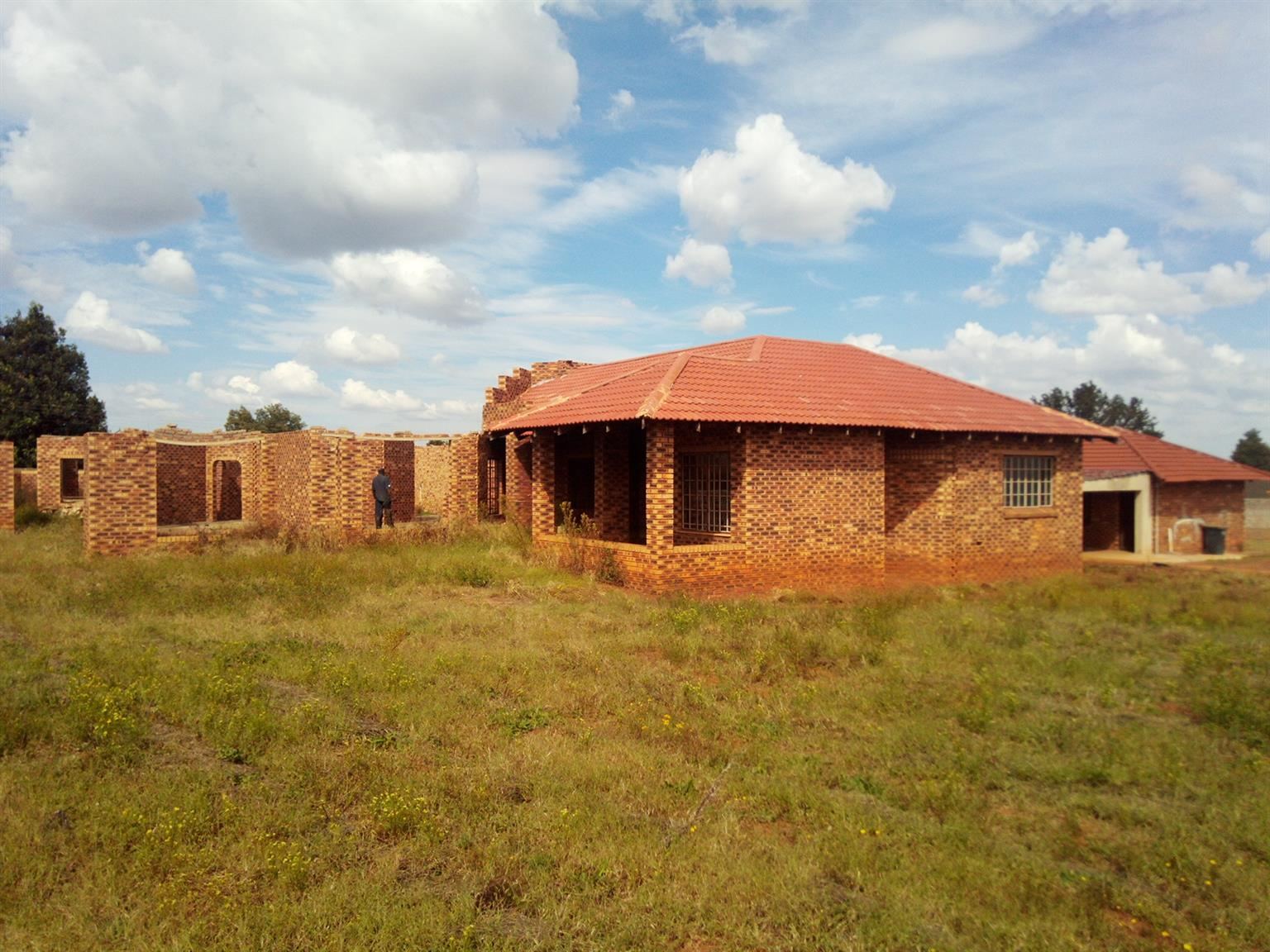 Randfontein South on main road half build face brick house
