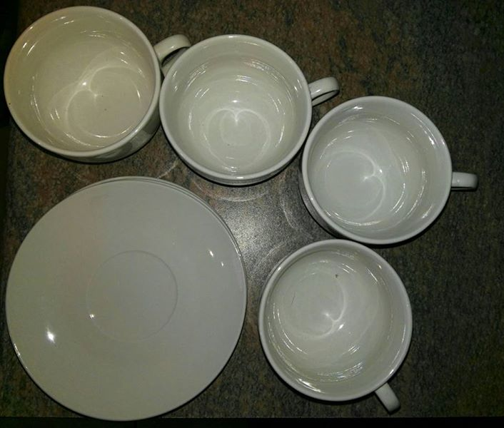 4 tee cups and 4 saucers