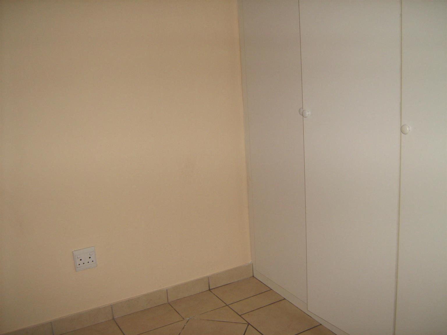 Spacious 2 Bedroom Apartment for sale in TILEBA , PRETORIA. Need and well managed complex