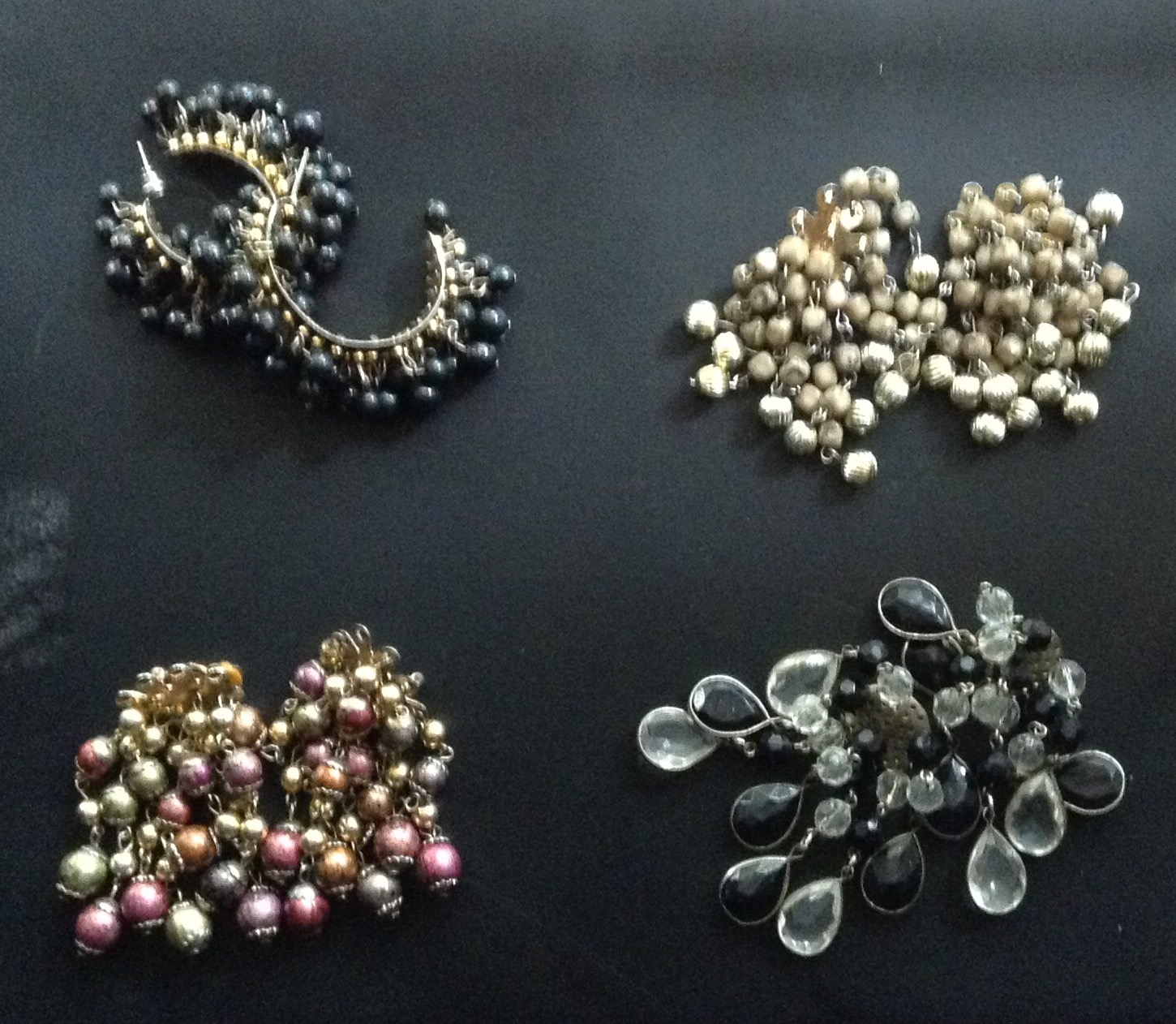 A set of four earrings for R200 plus get a FREE broach and earring set