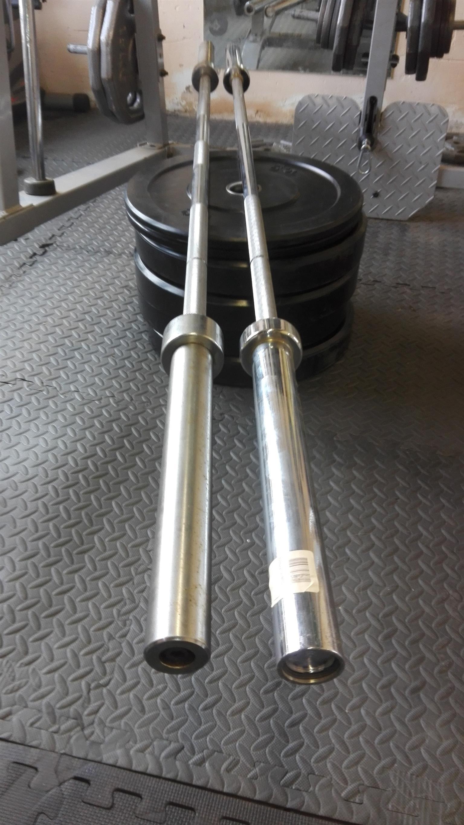 2 Olympic bars + 70kg Bumper Plates