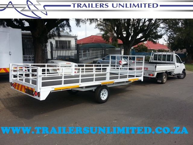 TRAILERS UNLIMITED FLATBED WITH DROP SIDES.