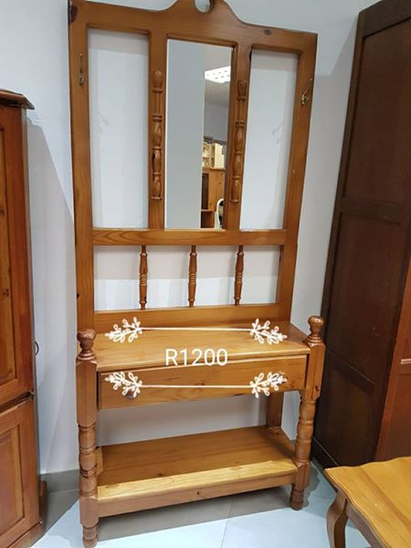Light wooden dresser with mirror
