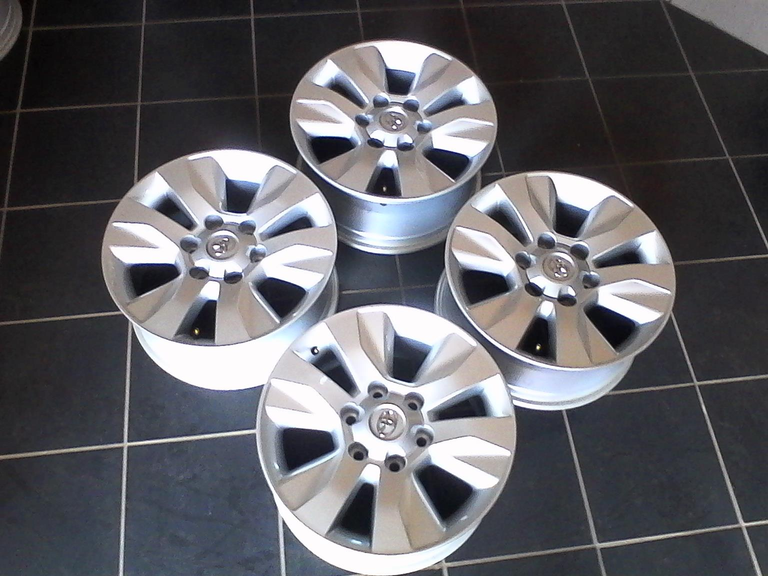 Set of Toyota hilux 17'' original mags 4x silver r4799 for your bakkie or SUV,