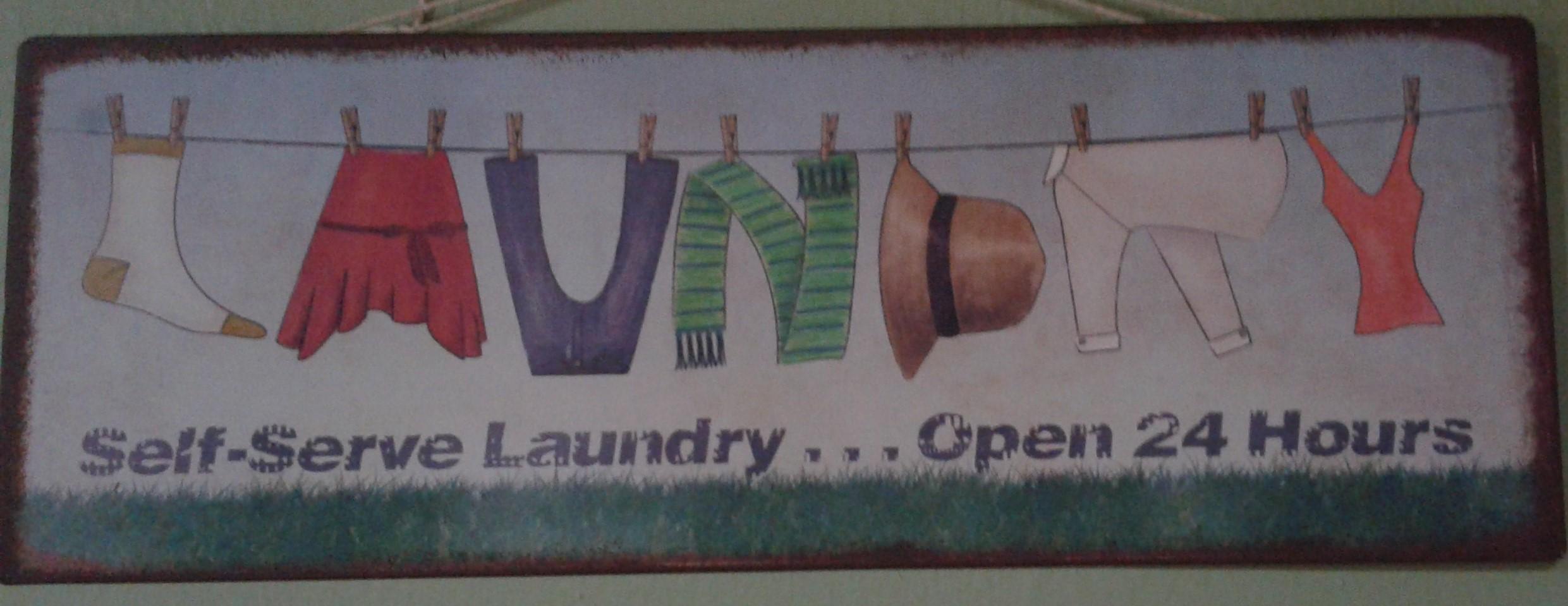 Metal plaque: Laundry...
