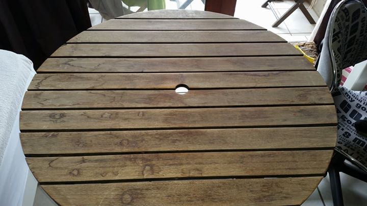 Round wooden porch table