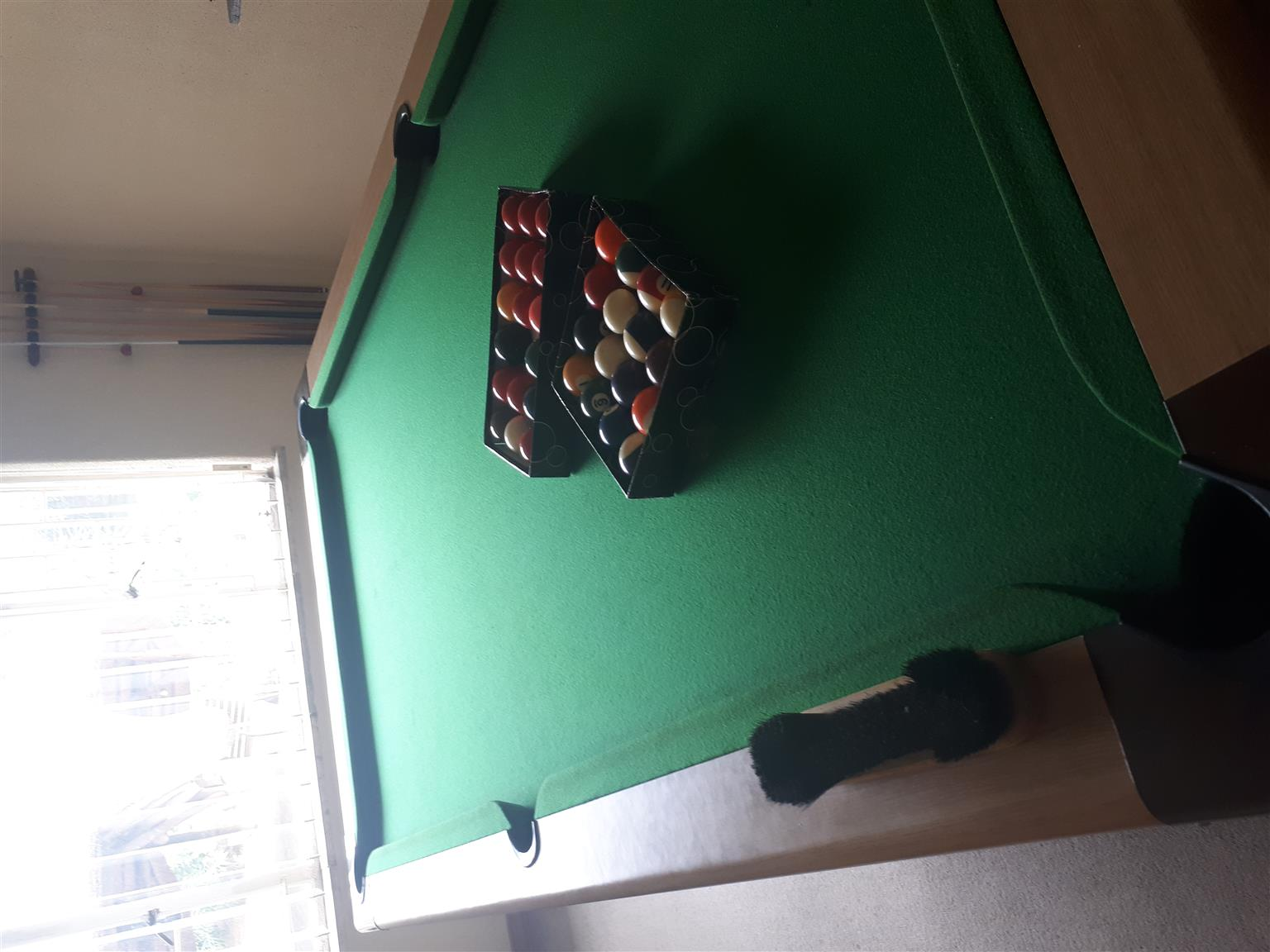 Granite top Pool Table, with mint condition balls (pool and snooker balls) and cues.