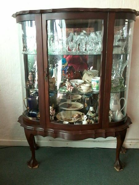 Antique ball and claw display cabinet