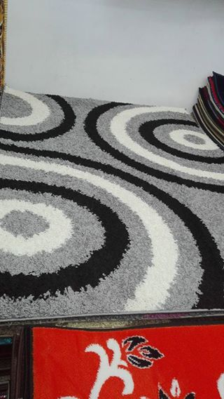Gray rug with black and white circle pattern