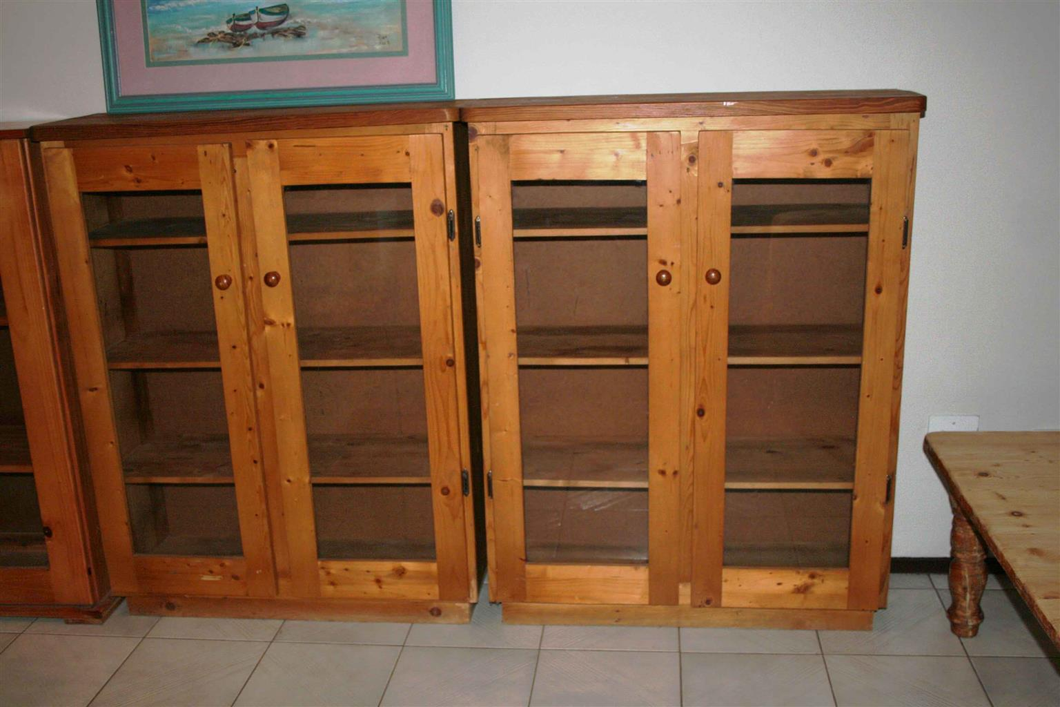 Book Shelfs Cupboards Four Cupboards Two Origon Knotty Pine and Two Pine with glass doors.