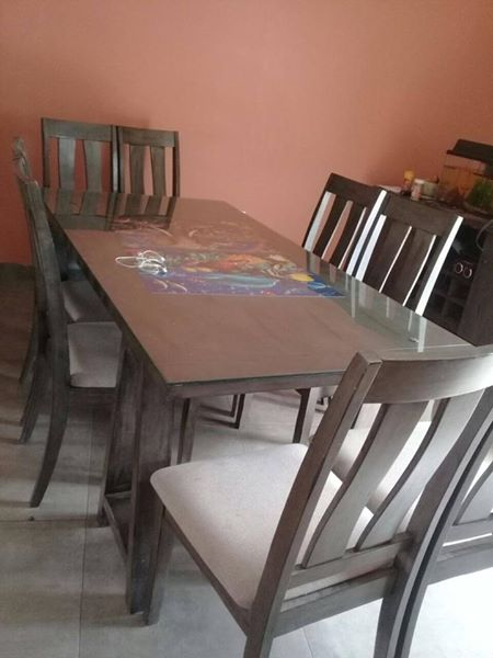 Dining room table, 8 chairs, and side board