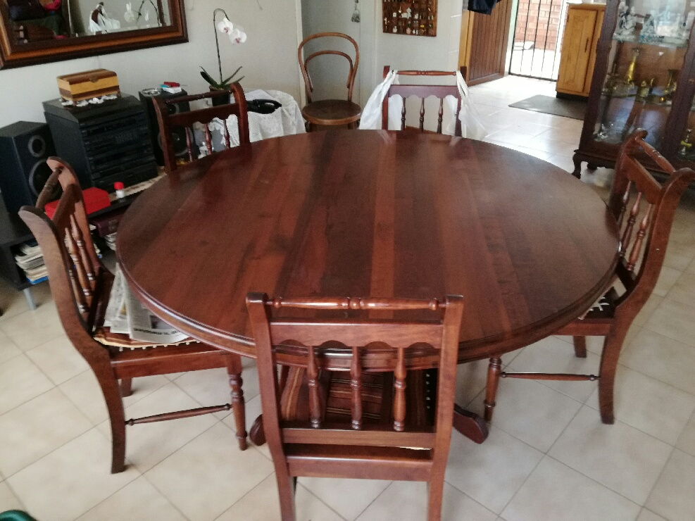 Excellent solid embuia round dining table with 6 riempie chairs