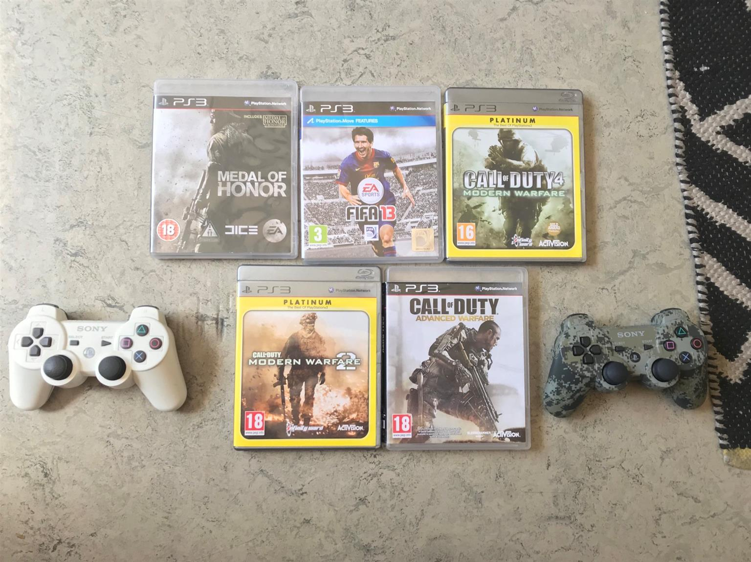 PS3 in MInt Condition + 3 Insane Looking Remote and 5 Great Games!!!