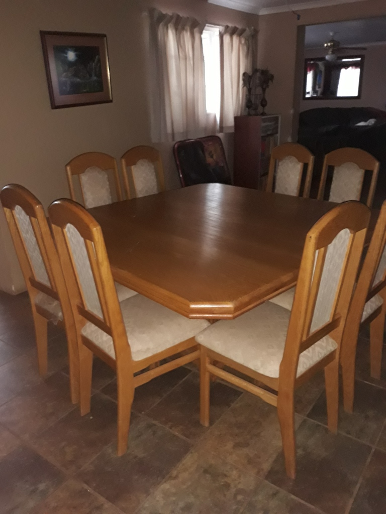"""""""Solid oak square 8 seater dining table with matching high back chairs."""