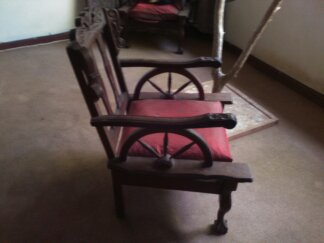 A Two Vintage Imbuia Wagon Wheel Wing Chairs for Sale