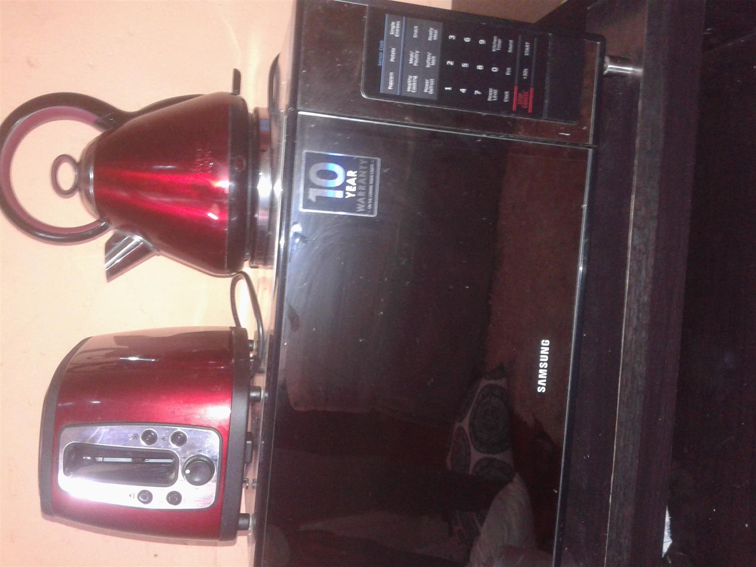 Samsung microwave with a Russell Hobbs toaster and kettle for sale