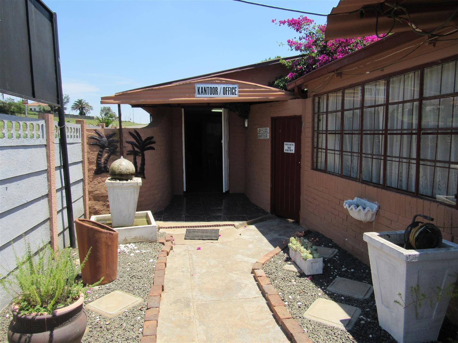 Business with house and 2 flats for sale