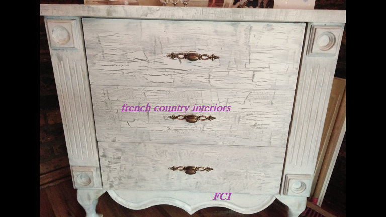 Chest of drawers in a heavy distressed and crackle finish