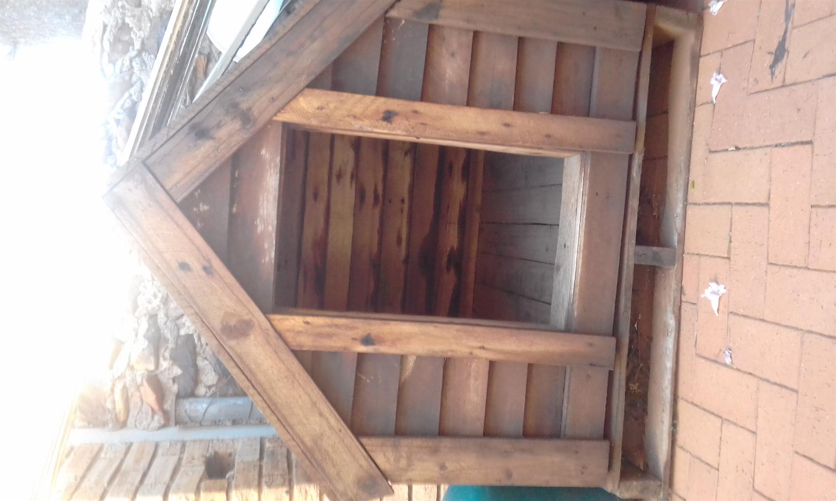 Big dog, wooden kennel