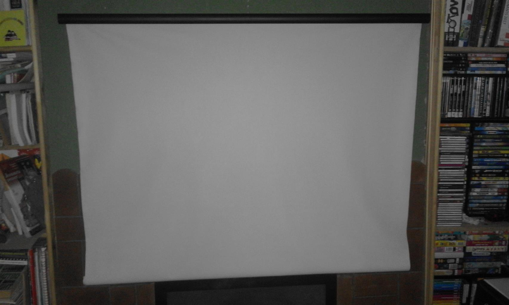 Projector screen 170cm (w) by 200cm (h).Wall attachable. R1000.