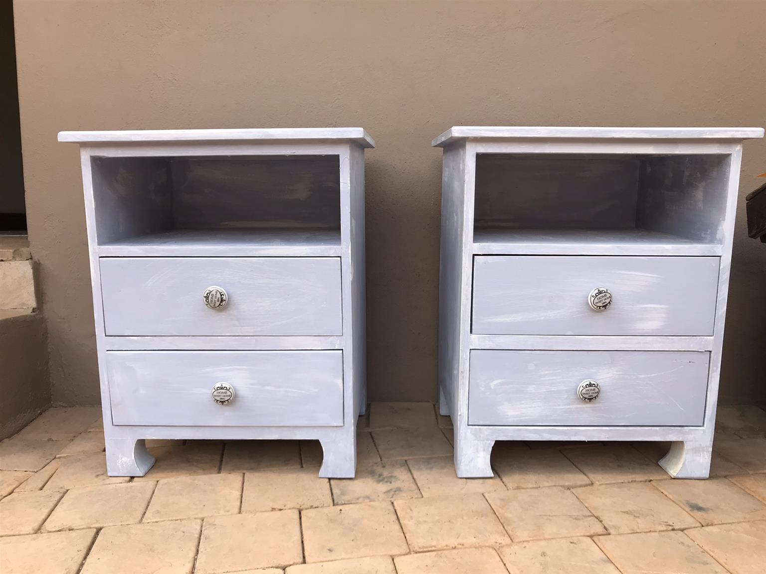 sleigh bed and side tables in soft blue hues