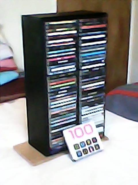 80 CD's in wooden CD rack for sale.