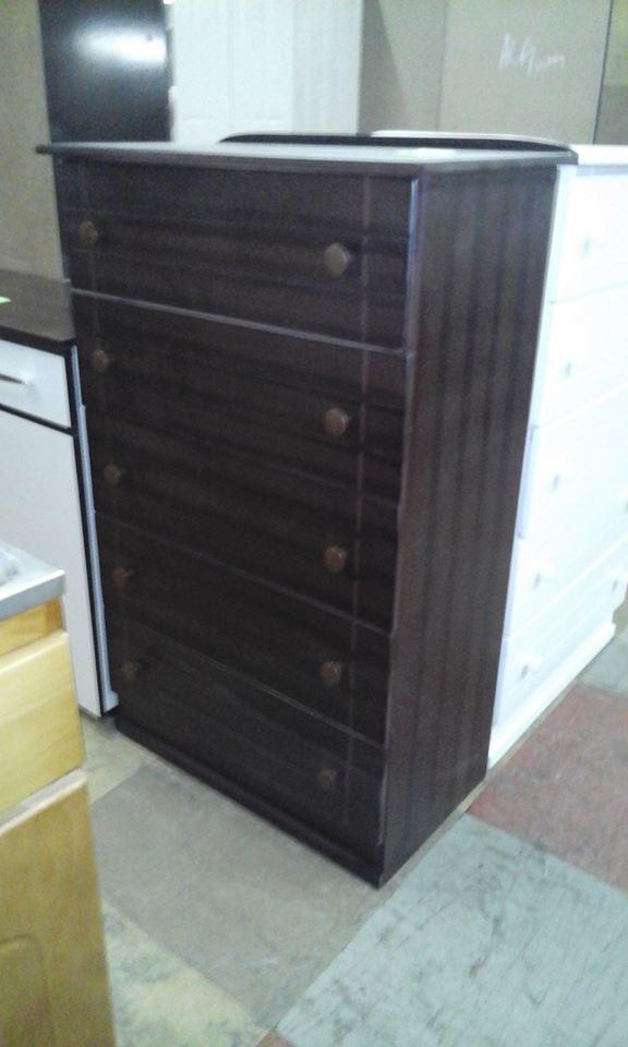 Dark wooden chest of drawers