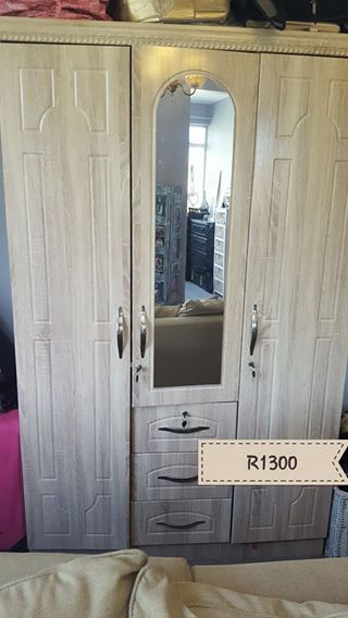 Wooden closet with mirror
